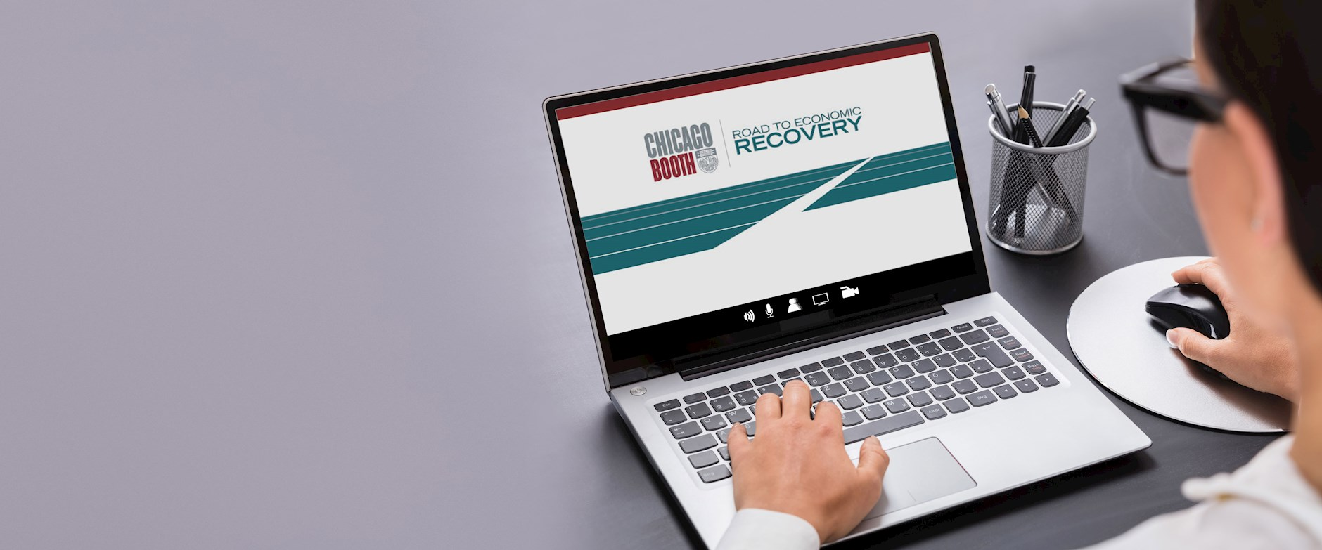 Person on computer looking at Road to Economic Recovery screen