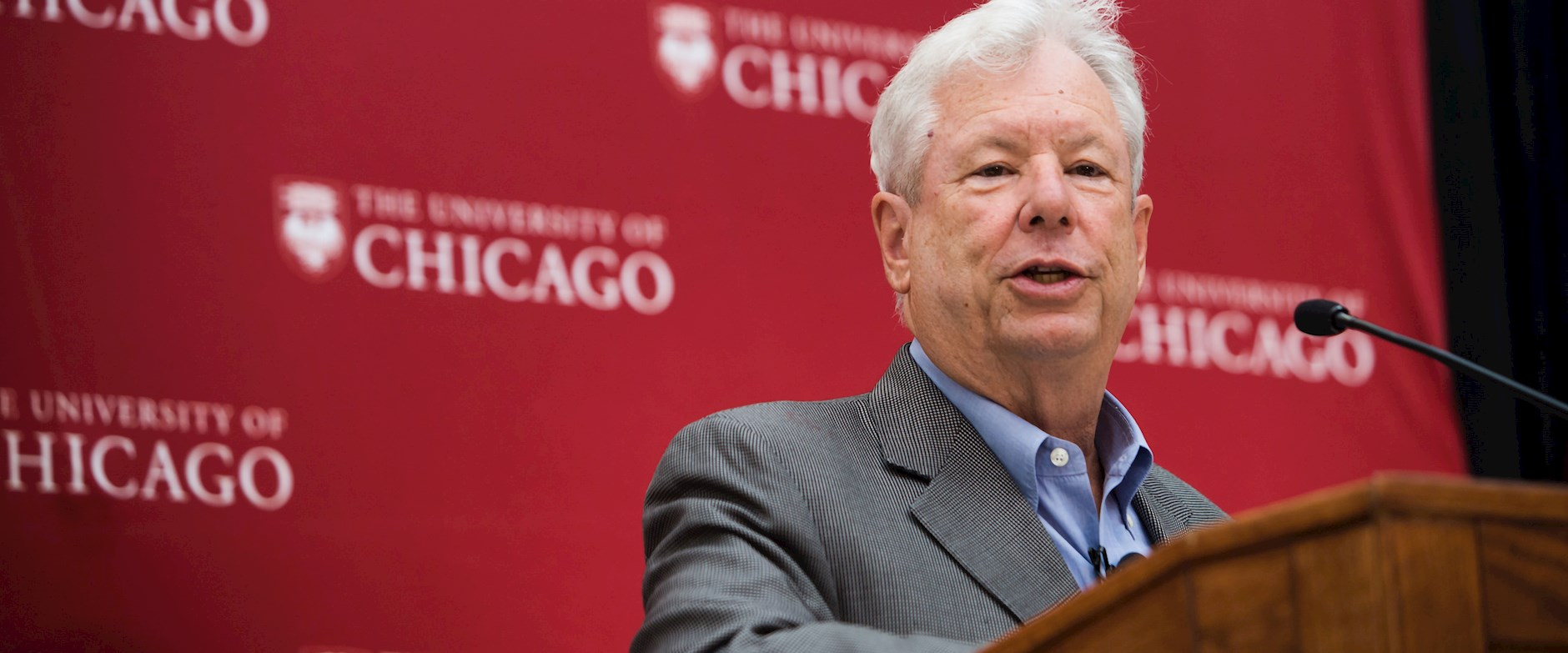 Chicago Booth Professor Richard Thaler standing at a podium, speaking after winning the 2017 Nobel Prize in Economics before a press conference at Harper